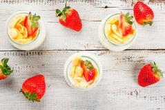 Yogurt with cornflakes and strawberries Stock Photo