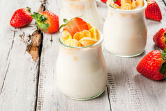 Yogurt with cornflakes and strawberries Royalty Free Stock Photo