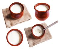Yogurt cream or  Cottage cheese curd in clay pot  isolated on a Royalty Free Stock Photography