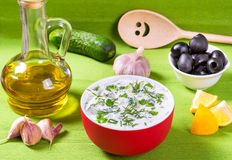 Yogurt with cucumber - Greek Tzatziki dip and bottle of olive oil.  Royalty Free Stock Photo