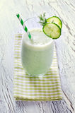 Yogurt and cucumber smoothie with dill on wooden background Stock Photo