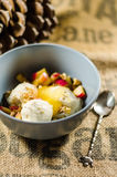 Yogurt; Cut Fruits; And Honey In Bowl By Spoon Royalty Free Stock Photography