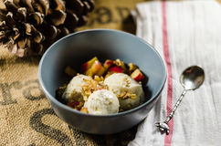 Yogurt; Cut Fruits And Nuts In Bowl Royalty Free Stock Photo