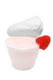 Yogurt de fruta no recipiente plástico no branco Imagem de Stock Royalty Free