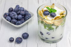 Yogurt dessert with blueberry, kiwi and cereals. In the glass Royalty Free Stock Image