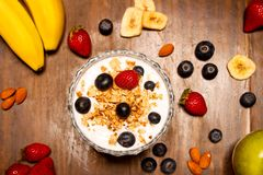 Healthy breakfast. Yogurt with strawberry and blueberries royalty free stock photos