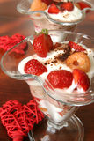 Yogurt dessert with fruits and hearts Royalty Free Stock Images