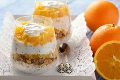 Yogurt dessert with muesli, chia seeds and oranges. Yogurt dessert with muesli, chia seeds and oranges stock images