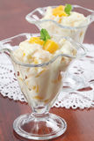 Yogurt dessert with peaches Royalty Free Stock Photos