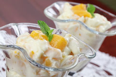 Yogurt dessert with peaches Royalty Free Stock Photography