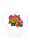 Yogurt with different fresh berries and mint in a glass beaker Royalty Free Stock Image