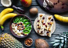 Yogurt with different fruits on a wooden background. Useful food, diet, organic. A Stock Photos