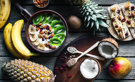 Yogurt with different fruits on a wooden background. Useful food, diet, organic. Royalty Free Stock Photo