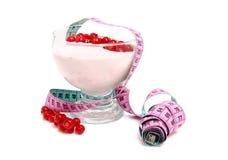 Yogurt dish with measure tape Royalty Free Stock Image