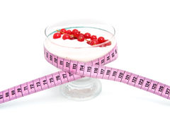 Yogurt dish with measure tape Royalty Free Stock Photography