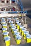 Yogurt filling and sealing machine Stock Image