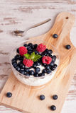 Yogurt with fresh berries for healthy morning meal Royalty Free Stock Photography