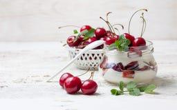 Yogurt with fresh cherries Stock Images