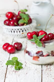 Yogurt with fresh cherries Stock Photo