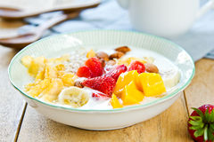 Yogurt with fresh fruits. Fresh fruits with oat, almond ,conflake in natural yogurt stock image