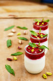 Yogurt with fresh raspberry and pistachio with copy space Royalty Free Stock Photography