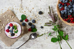 Yogurt with fresh ripe berries, oats and mint. healthy breakfast Stock Photo