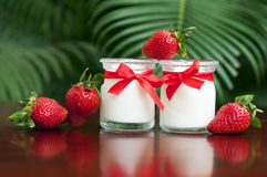 Yogurt with fresh strawberries on the background. Yogurt with fresh strawberries on the wooden background Stock Image