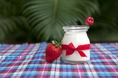 Yogurt with fresh strawberries. On the table Stock Photos