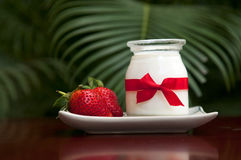 Yogurt with fresh strawberries. On the table Royalty Free Stock Images