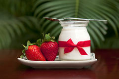 Yogurt with fresh strawberries. On the table Stock Photography