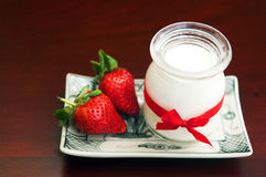 Yogurt with fresh strawberries. On the table Stock Photo