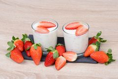 Yogurt with fresh strawberries Stock Images