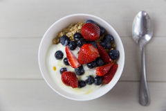 Yogurt and fruit breakfast cereal bowl. Healthy brekfast bowl viewed from above Stock Image