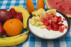 Yogurt with fruit pieces. Fruit on the table Stock Photo