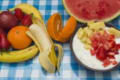 Yogurt with fruit pieces. Fruit on the table Stock Image