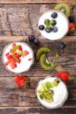 Yogurt and fruit Stock Images