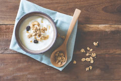 Yogurt garnish with cereal in a bowl on woodtable. Yogurt garnish with cereal in a bowl on an old wood table Stock Image