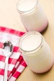 Yogurt in glass jar Royalty Free Stock Photo