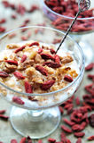 Yogurt with goji and walnuts Royalty Free Stock Images