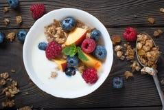 Yogurt with Granola  and fresh berries Stock Photo