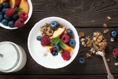 Yogurt with Granola  and fresh berries. On  wooden table. Healthy breakfast Royalty Free Stock Image