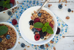Yogurt with Granola and fresh berries. On wooden table. Healthy breakfast Royalty Free Stock Photos