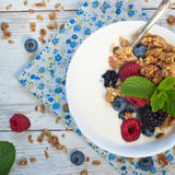 Yogurt with Granola and fresh berries. On wooden table. Healthy breakfast Stock Photography