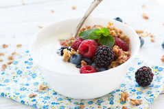 Yogurt with Granola and fresh berries. On wooden table. Healthy breakfast Royalty Free Stock Photography