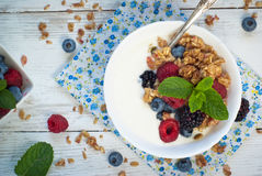 Yogurt with Granola and fresh berries. On wooden table. Healthy breakfast Stock Photo