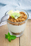 Yogurt with granola and fruits. Concept of healthy eating. Royalty Free Stock Photo