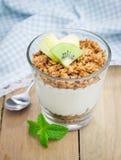 Yogurt with granola and fruits Stock Image