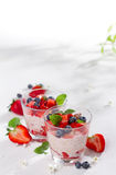 Yogurt with granola or muesli and berries Stock Photography