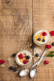 Yogurt with granola or muesli and fresh berries Royalty Free Stock Photos