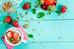 Yogurt with granola, nuts and fresh strawberry Stock Image